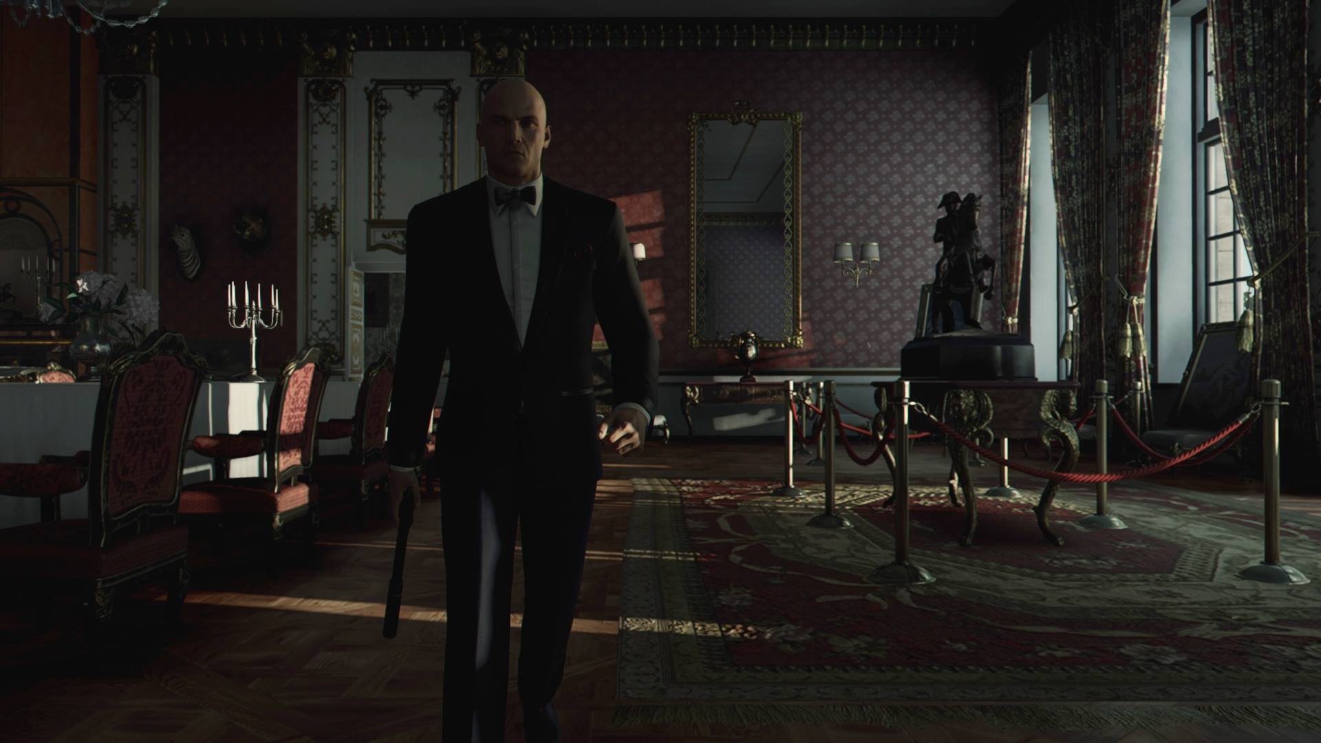 Agent 47 i Paris med pistol i hand. Foto: IO Interactive